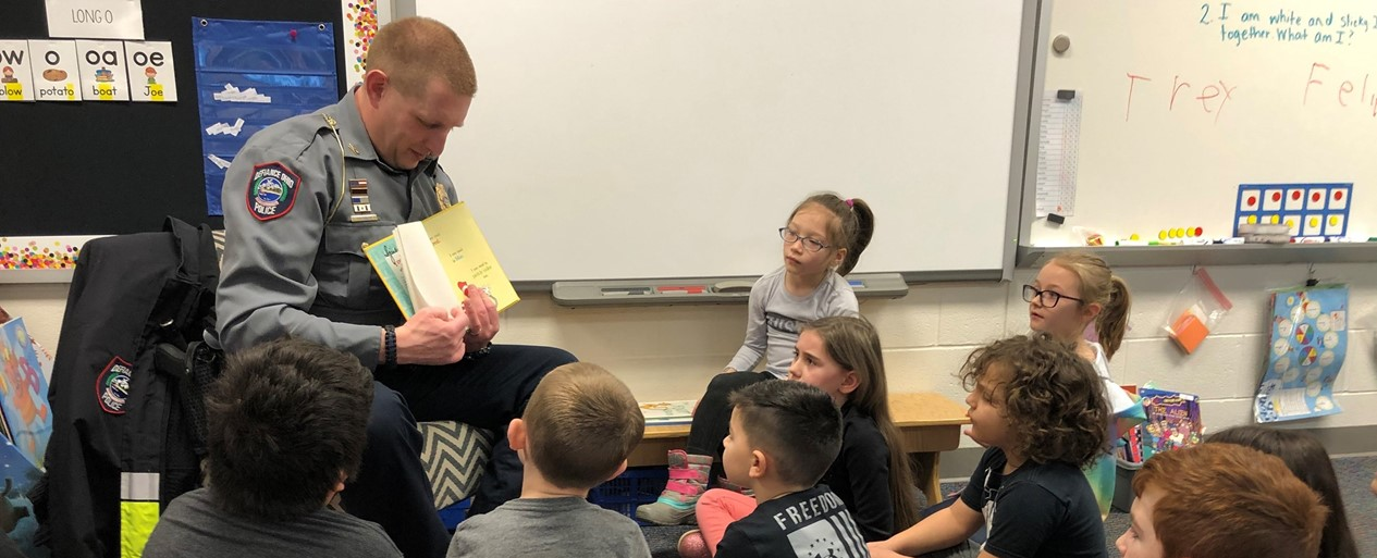 Officer reading Dr. Seuss